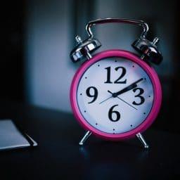 An alarm clock on a nightstand.